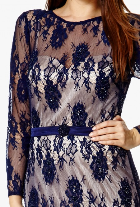 Navy lace over nude, long sleeved evening dress