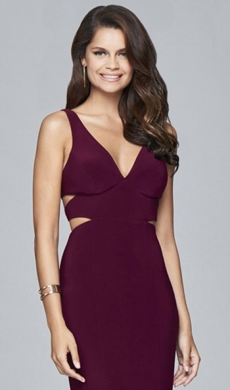 Plain jersey evening dress with cut outs